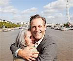 Smiling couple hugging along the Thames river in London Stock Photo - Premium Royalty-Freenull, Code: 635-05656340