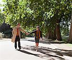 Couple holding hands and walking in park Stock Photo - Premium Royalty-Freenull, Code: 635-05656344
