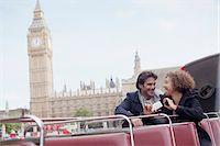 Couple with digital camera riding double decker bus near Big Ben clocktower in London Stock Photo - Premium Royalty-Freenull, Code: 635-05656349