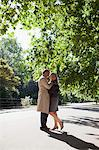 Couple hugging face to face in sunny park Stock Photo - Premium Royalty-Freenull, Code: 635-05656397