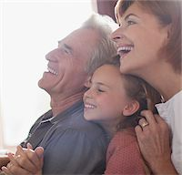 Happy grandparents and granddaughter hugging Stock Photo - Premium Royalty-Freenull, Code: 635-05656405