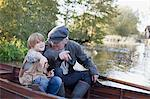 Grandfather and grandson pointing from boat in lake Stock Photo - Premium Royalty-Freenull, Code: 635-05656418
