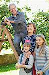 Smiling multi-generation family in apple orchard Stock Photo - Premium Royalty-Free, Artist: Blend Images, Code: 635-05656457