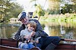 Grandfather and grandson fishing in boat Stock Photo - Premium Royalty-Freenull, Code: 635-05656479