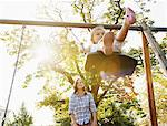 Mother pushing daughter on swing in sunny park Stock Photo - Premium Royalty-Free, Artist: Blend Images, Code: 635-05656507