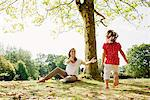 Girl running to mother in park Stock Photo - Premium Royalty-Freenull, Code: 635-05656512
