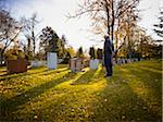 Man Looking at Headstone in Cemetery Stock Photo - Premium Rights-Managed, Artist: Matthew Plexman, Code: 700-05656528