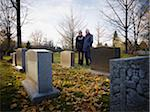 Couple Grieving in Cemetery Stock Photo - Premium Rights-Managed, Artist: Matthew Plexman, Code: 700-05656531
