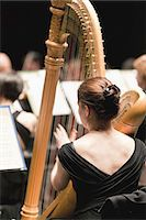 Harp player in orchestra Stock Photo - Premium Royalty-Freenull, Code: 649-05656611