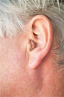 Close up of older person's hearing aid Stock Photo - Premium Royalty-Freenull, Code: 649-05656941