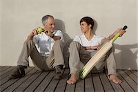 Father and son with cricket bat on patio Stock Photo - Premium Royalty-Freenull, Code: 649-05656975