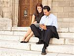 Business people working on stone steps Stock Photo - Premium Royalty-Free, Artist: Blend Images, Code: 649-05657004