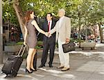 Business people shaking hands outdoors Stock Photo - Premium Royalty-Free, Artist: Blend Images, Code: 649-05657013