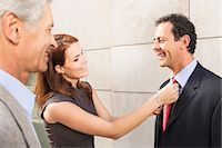 Businesswoman adjusting colleague's tie Stock Photo - Premium Royalty-Freenull, Code: 649-05657037