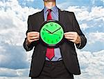 Businessman holding clock Stock Photo - Premium Royalty-Free, Artist: Ikon Images, Code: 649-05657041