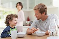 Family eating breakfast in kitchen Stock Photo - Premium Royalty-Freenull, Code: 649-05657165