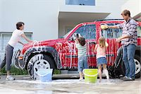 Family washing car together Stock Photo - Premium Royalty-Freenull, Code: 649-05657237
