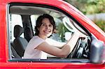 Woman smiling in driver's seat of car Stock Photo - Premium Royalty-Free, Artist: Blend Images, Code: 649-05657239