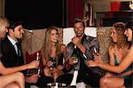 Friends drinking champagne in club Stock Photo - Premium Royalty-Free, Artist: Harald Vorsteher, Code: 649-05657356