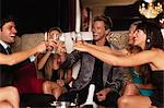 Friends toasting each other in club Stock Photo - Premium Royalty-Free, Artist: Cultura RM, Code: 649-05657358