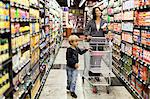 Woman grocery shopping with son Stock Photo - Premium Royalty-Free, Artist: Arcaid, Code: 649-05657460