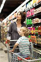 Woman grocery shopping with son Stock Photo - Premium Royalty-Freenull, Code: 649-05657461
