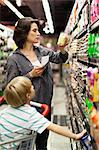 Woman grocery shopping with son Stock Photo - Premium Royalty-Free, Artist: Science Faction, Code: 649-05657463