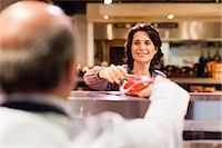 Woman buying meat from butcher Stock Photo - Premium Royalty-Freenull, Code: 649-05657473