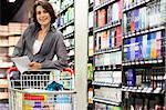 Smiling woman grocery shopping Stock Photo - Premium Royalty-Free, Artist: Blend Images, Code: 649-05657475