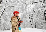Woman drinking coffee in snow Stock Photo - Premium Royalty-Free, Artist: Ikon Images, Code: 649-05657675