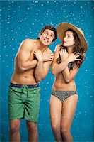 shirtless men - Couple in swimsuits shivering in snow Stock Photo - Premium Royalty-Freenull, Code: 649-05657787