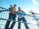 Workers talking at construction site Stock Photo - Premium Royalty-Free, Artist: Aflo Relax, Code: 649-05657948
