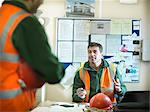 Construction workers talking in office Stock Photo - Premium Royalty-Free, Artist: Aflo Relax, Code: 649-05657963