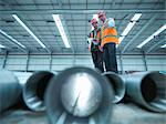 Workers examining pipes in warehouse Stock Photo - Premium Royalty-Free, Artist: foodanddrinkphotos, Code: 649-05657970