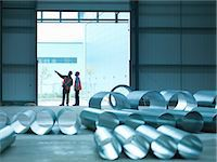 pipe (industry) - Workers examining warehouse walls Stock Photo - Premium Royalty-Freenull, Code: 649-05657971