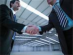 Businessmen shaking hands in warehouse Stock Photo - Premium Royalty-Free, Artist: Aflo Relax, Code: 649-05657978