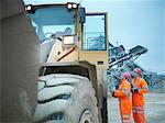 Workers talking to digger driver on site Stock Photo - Premium Royalty-Free, Artist: AWL Images, Code: 649-05658006