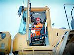 Worker driving industrial digger on site Stock Photo - Premium Royalty-Freenull, Code: 649-05658008