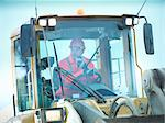 Worker driving industrial digger on site Stock Photo - Premium Royalty-Free, Artist: AWL Images, Code: 649-05658011