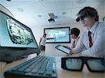 Scientists wearing 3D glasses in lab Stock Photo - Premium Royalty-Freenull, Code: 649-05658044