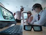 Scientists wearing 3D glasses in lab Stock Photo - Premium Royalty-Freenull, Code: 649-05658045