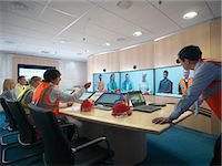 Construction workers in video conference Stock Photo - Premium Royalty-Freenull, Code: 649-05658055