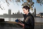 Woman reading guidebook of London Stock Photo - Premium Royalty-Free, Artist: ableimages, Code: 649-05658267