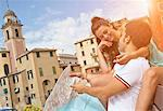Couple on vacation reading map Stock Photo - Premium Royalty-Free, Artist: Cultura RM, Code: 649-05658422