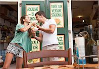 Couple sharing food at cafe Stock Photo - Premium Royalty-Freenull, Code: 649-05658423