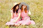 Two girls at contryside in red dresses. Stock Photo - Royalty-Free, Artist: massonforstock                , Code: 400-05663735