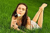 Girl with dandelion on green field Stock Photo - Royalty-Freenull, Code: 400-05663979