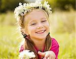 Portrait of a little girl in wreath of flowers Stock Photo - Royalty-Free, Artist: tan4ikk                       , Code: 400-05664256