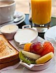 Breakfast with orange juice and fresh fruits on table Stock Photo - Royalty-Free, Artist: ilolab                        , Code: 400-05665721