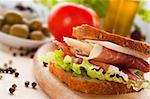 Prosciutto and cheese sandwich with olives and lettuce. Stock Photo - Royalty-Free, Artist: mythja                        , Code: 400-05666518